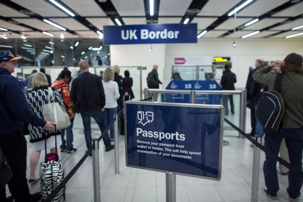 Border-Force-check-the-passports-of-passengers-arriving-at-Gatwick-Airport